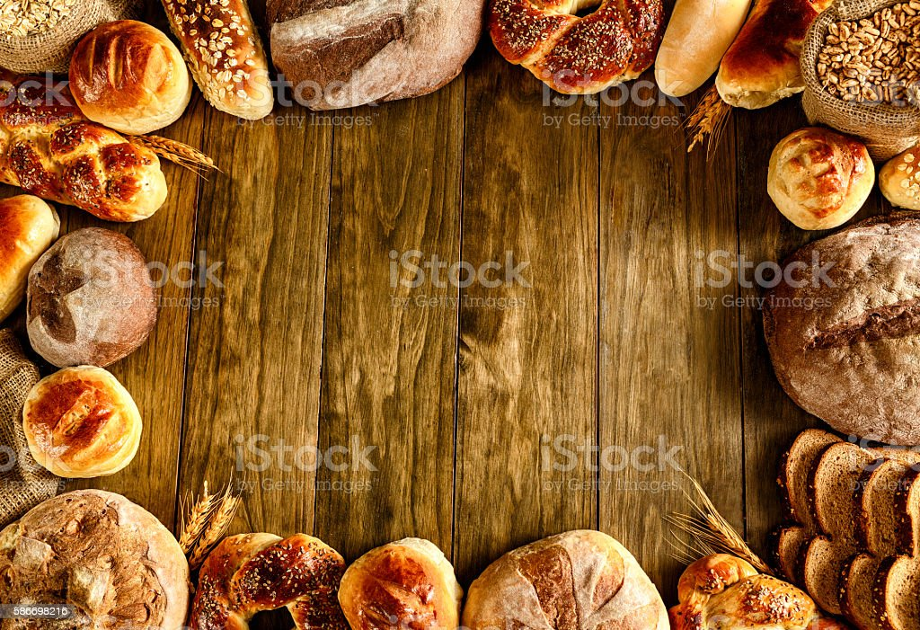 Artisanal bakery:  Frame of fresh mixed Bun, rolls and Bread stock photo
