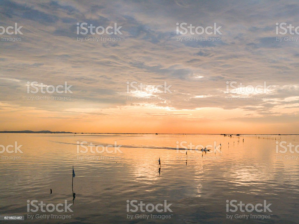 artisanal fisheries with sunset scenes stock photo