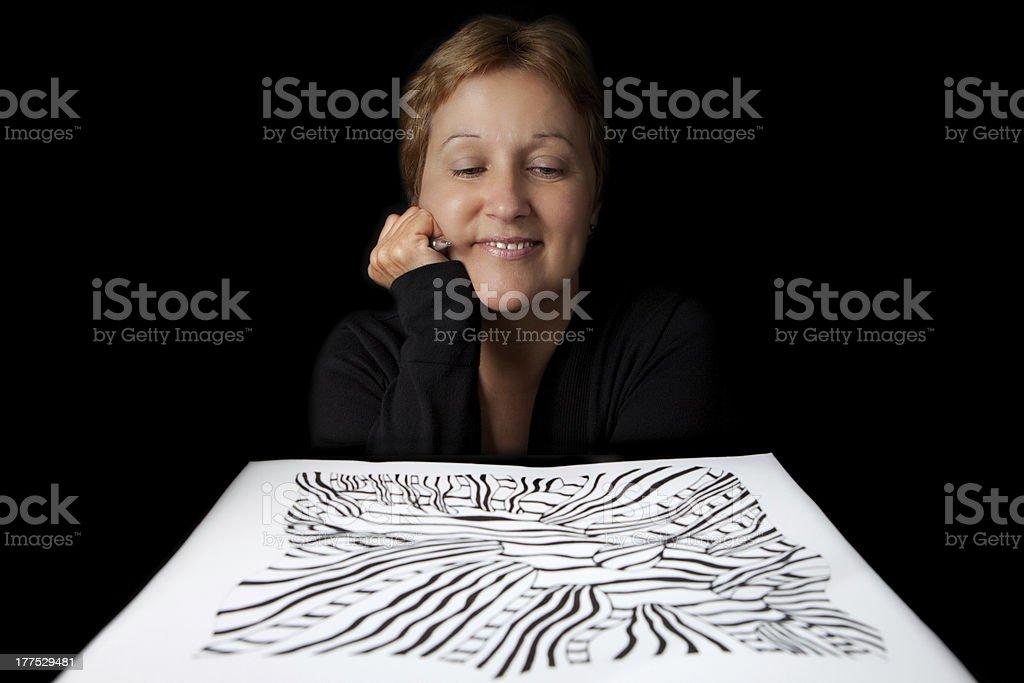Artist admiring her work stock photo
