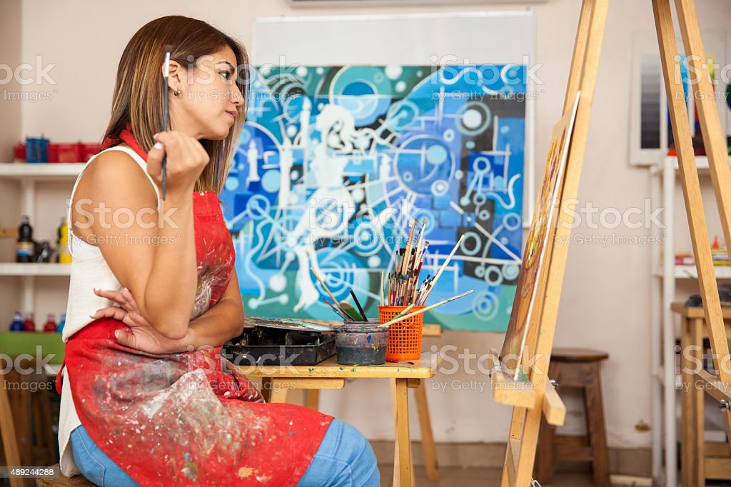 Artist analyzing her own work stock photo