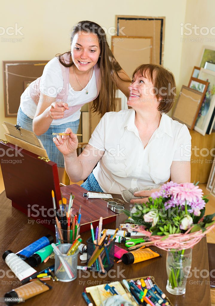 Artist and buyer in the art studio stock photo