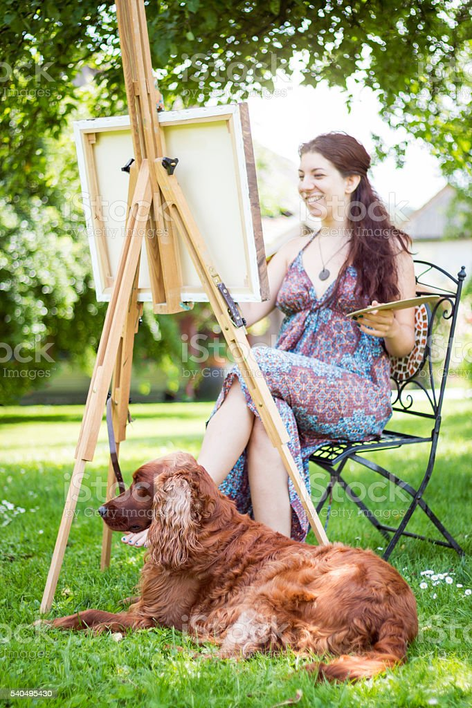 Artist and her dog stock photo