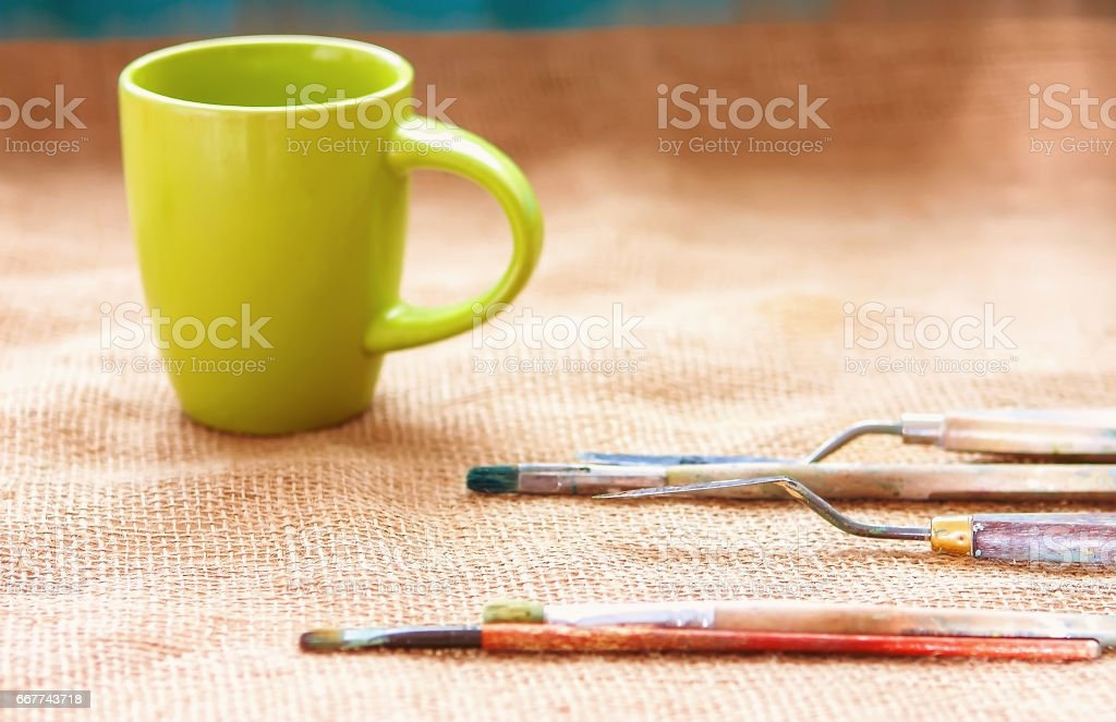 artist brush lying on sackcloth, Paint brushes and palette knife, oil painting impressionism, stock photo