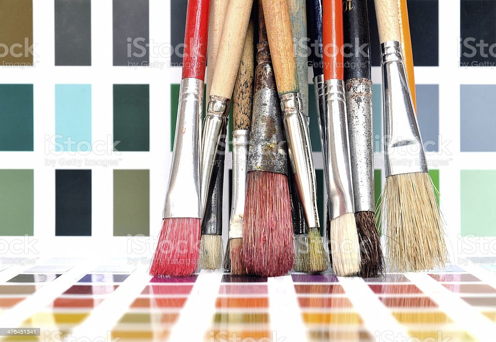 Artist brushes and color swatch stock photo