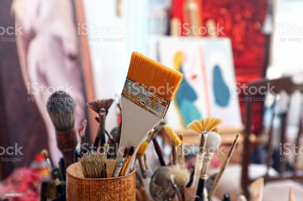 Artist brushes in a studio stock photo