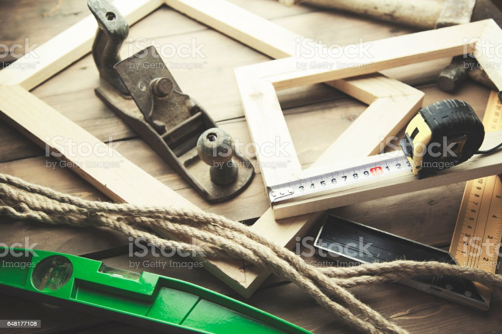 Artist canvas, canvas stretcher and staple gun on table stock photo