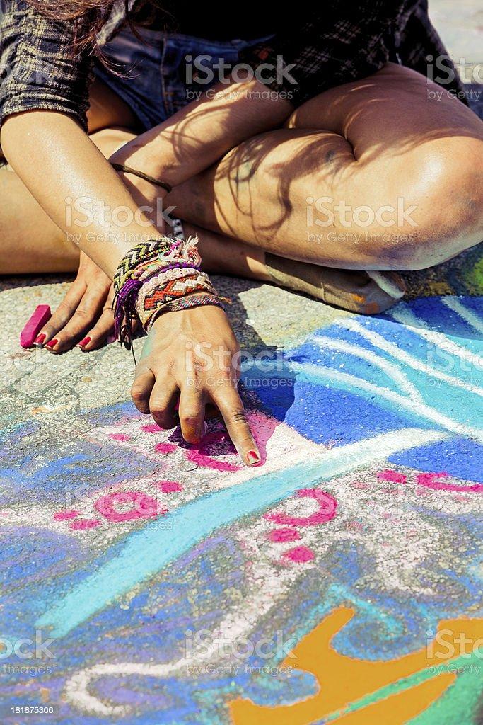 Artist doing a Bright chalk street painting stock photo