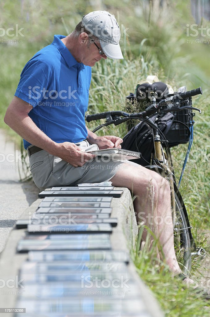 Artist Drawing and Selling Artwork on Seawall royalty-free stock photo