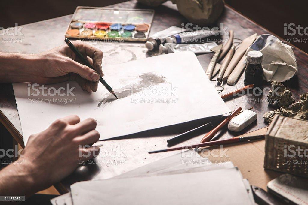 Artist drawing stock photo
