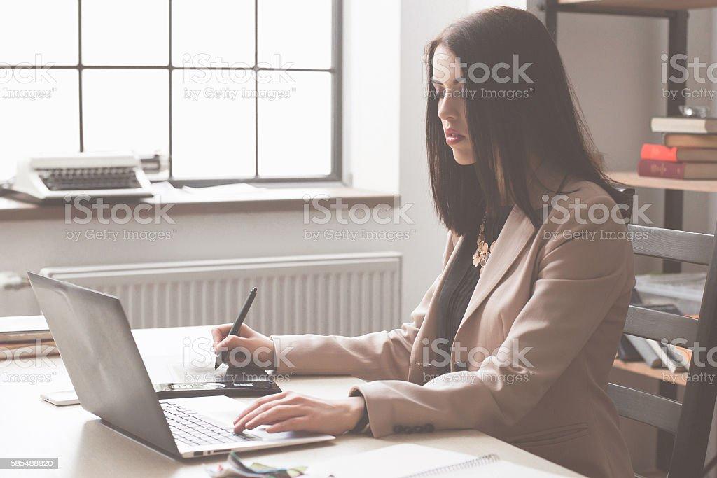 Artist drawing something on graphic tablet stock photo