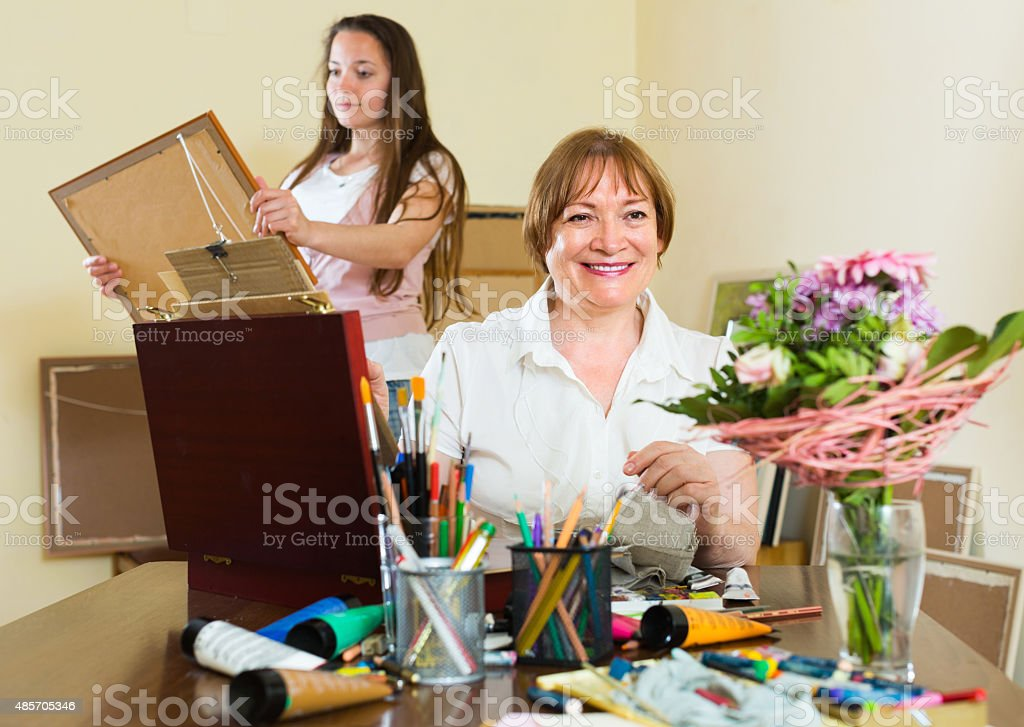 Artist draws a picture for client stock photo