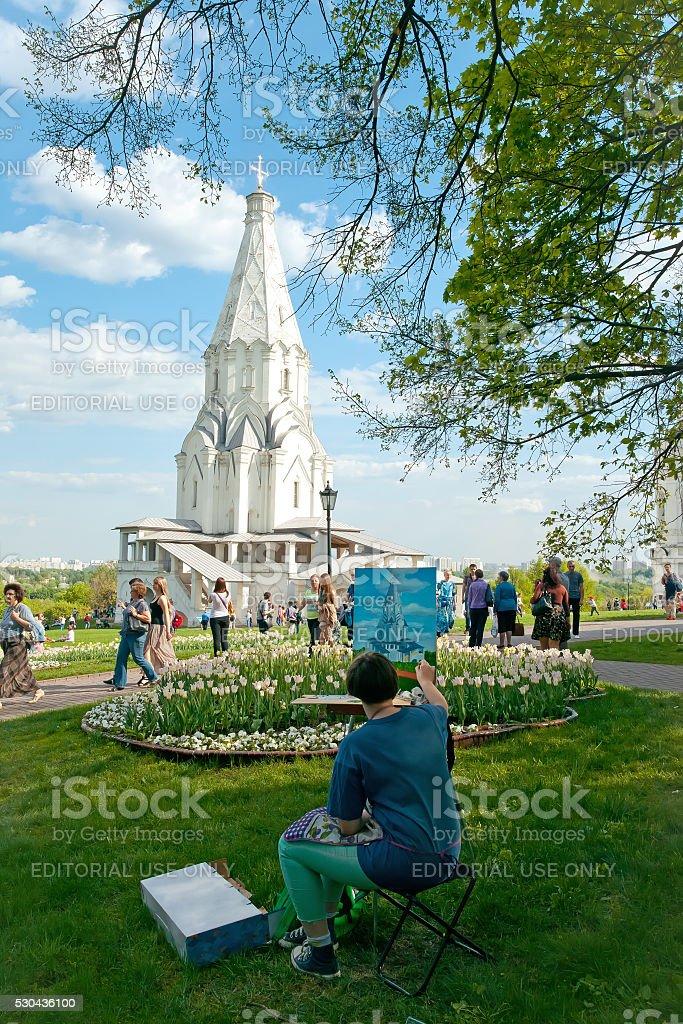 Artist draws christian temple in Kolomenskoye park. Moscow. stock photo