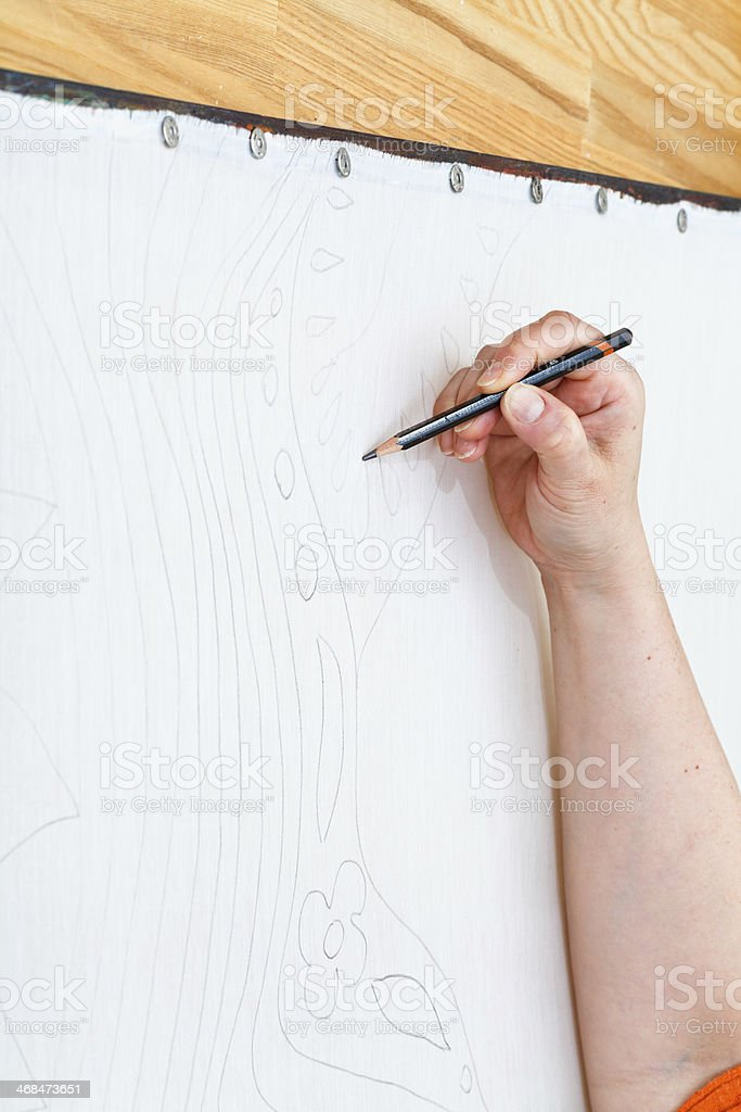 artist draws sketch by pencil on silk royalty-free stock photo