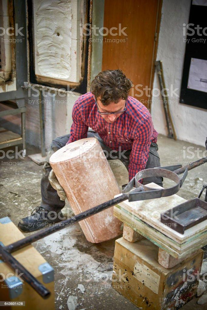 Artist handling mold for a sculpture stock photo