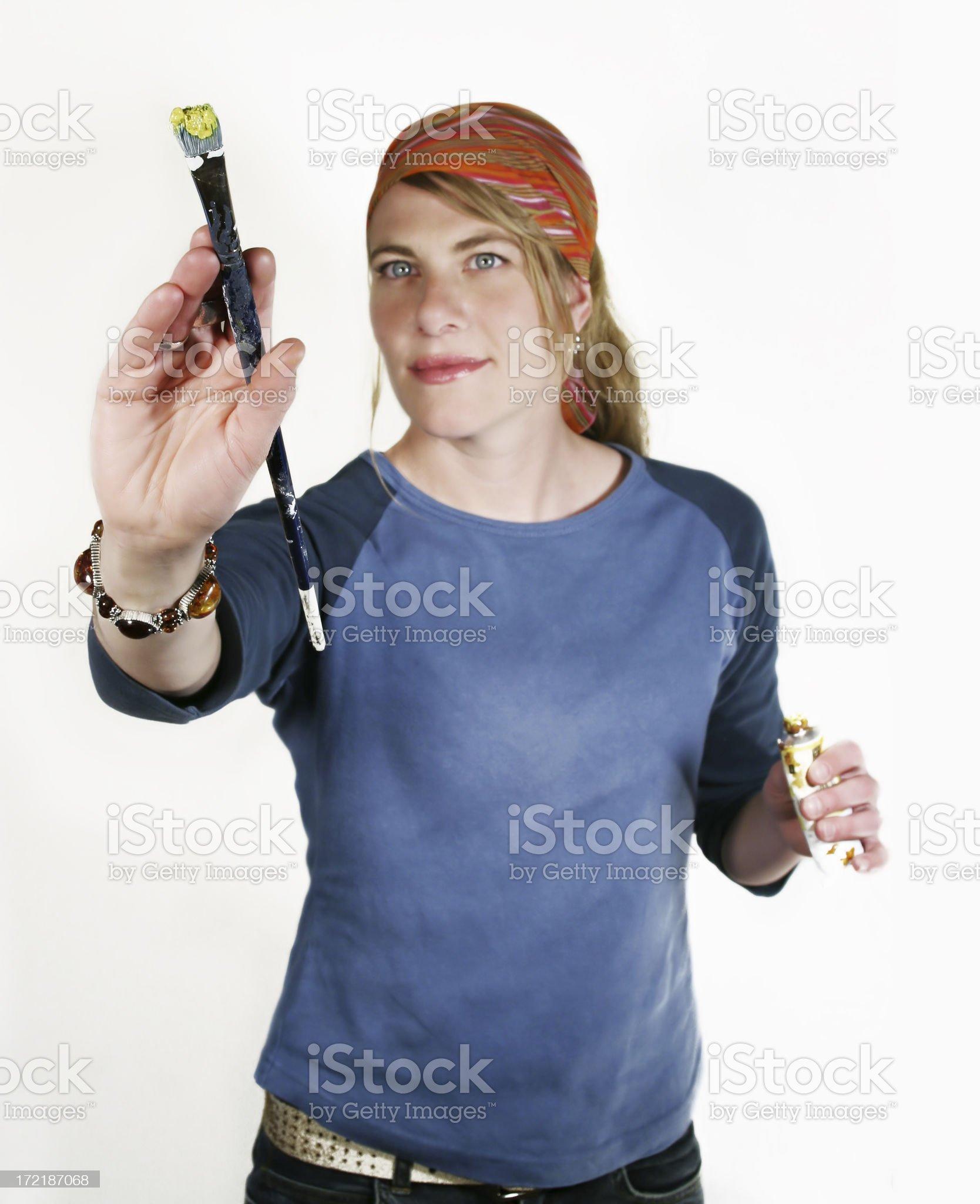 Artist holding up a paintbrush royalty-free stock photo