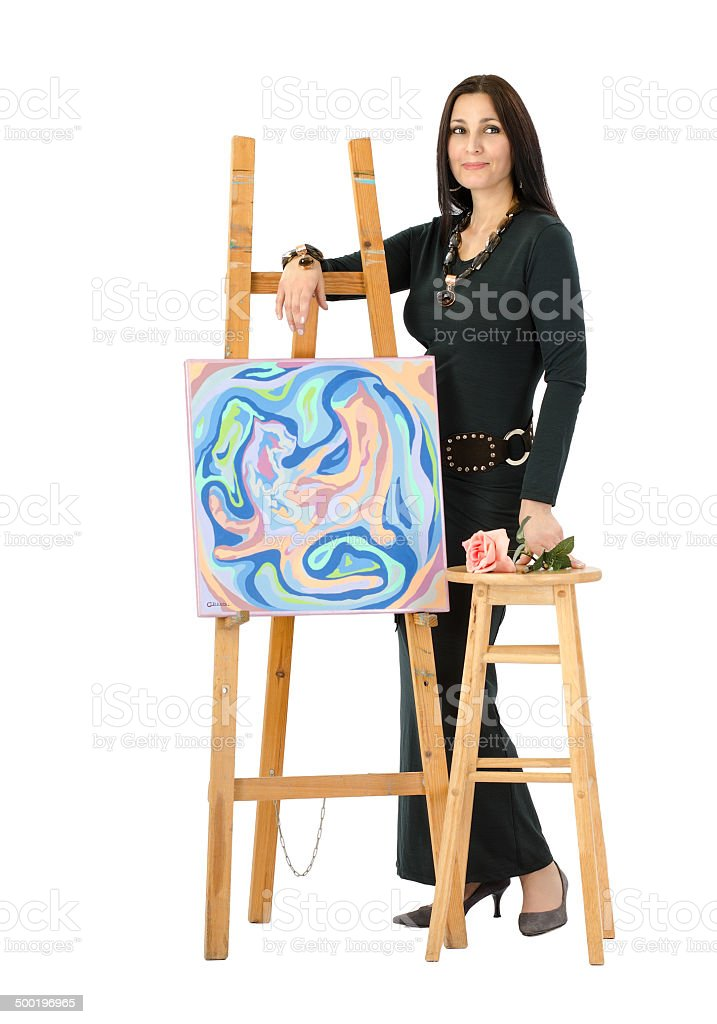 Artist leaning on an easel with abstract painting Cats stock photo