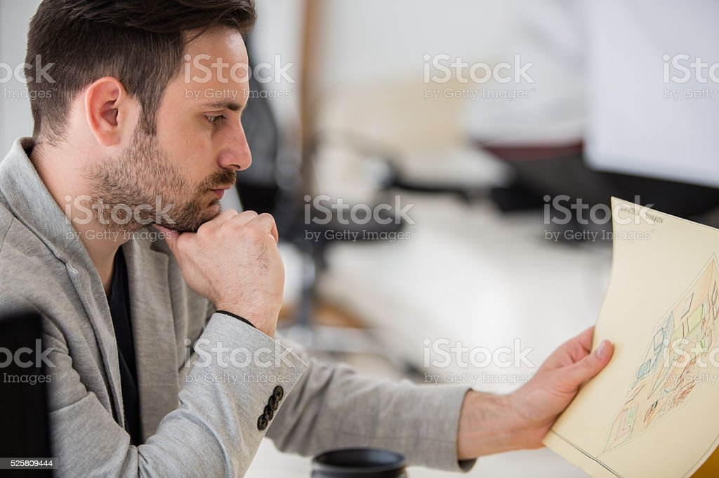 Artist looking at drawings stock photo