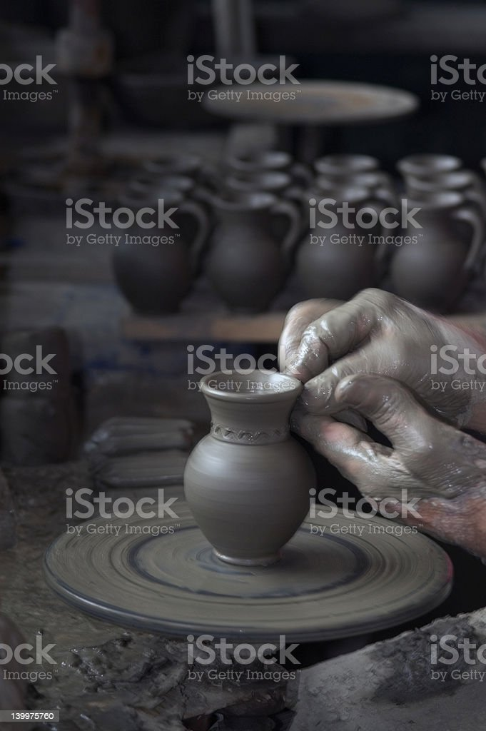 artist making black pottery stock photo