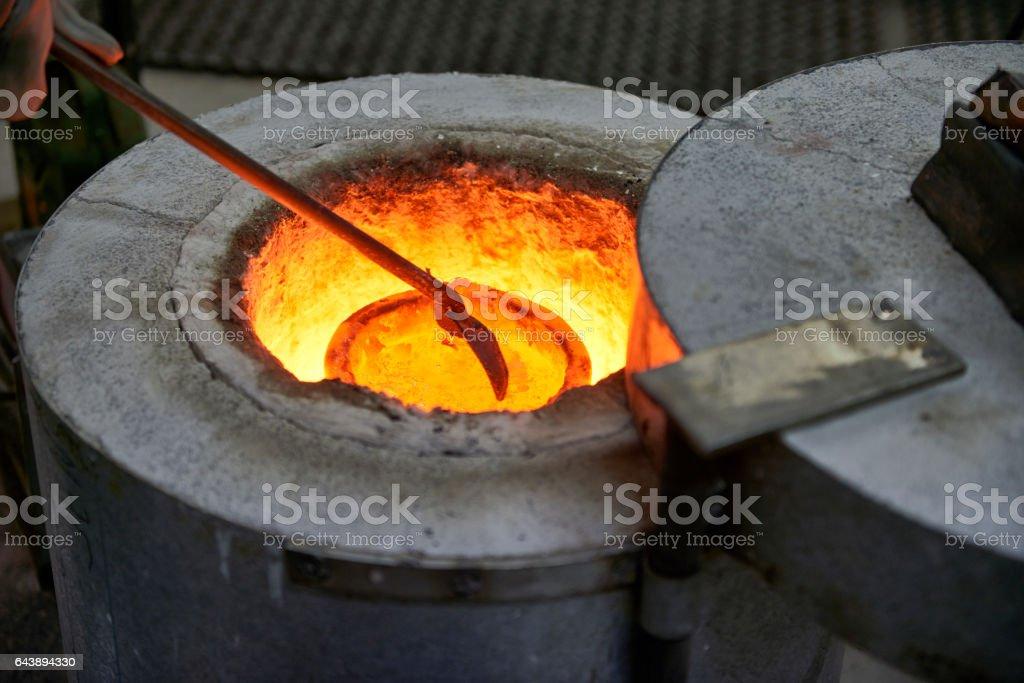 Artist melting Bronze before casting a bronze scuplture stock photo
