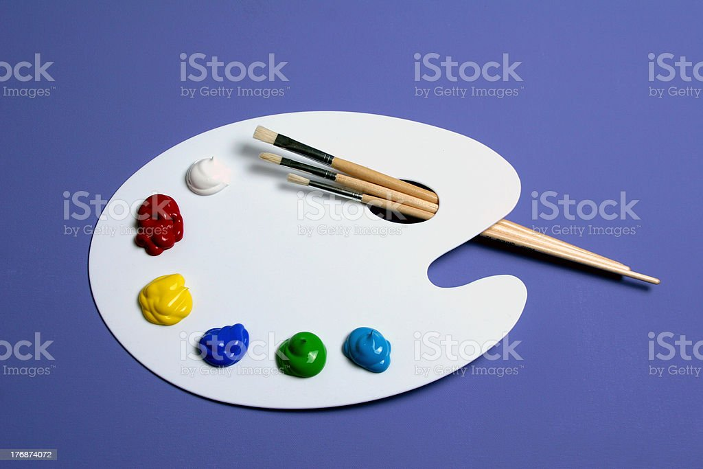 Artist Paint Palette with Paints and Brushes, Symbolic of Art royalty-free stock photo