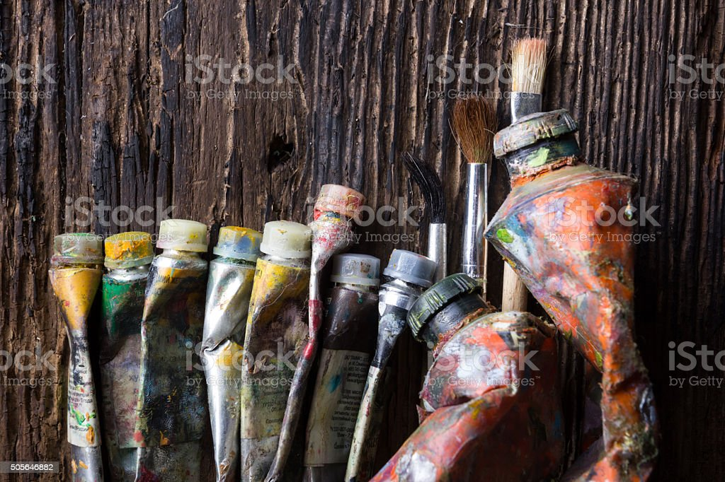 Artist paintbrushes close up on old natural wooden desk background. stock photo