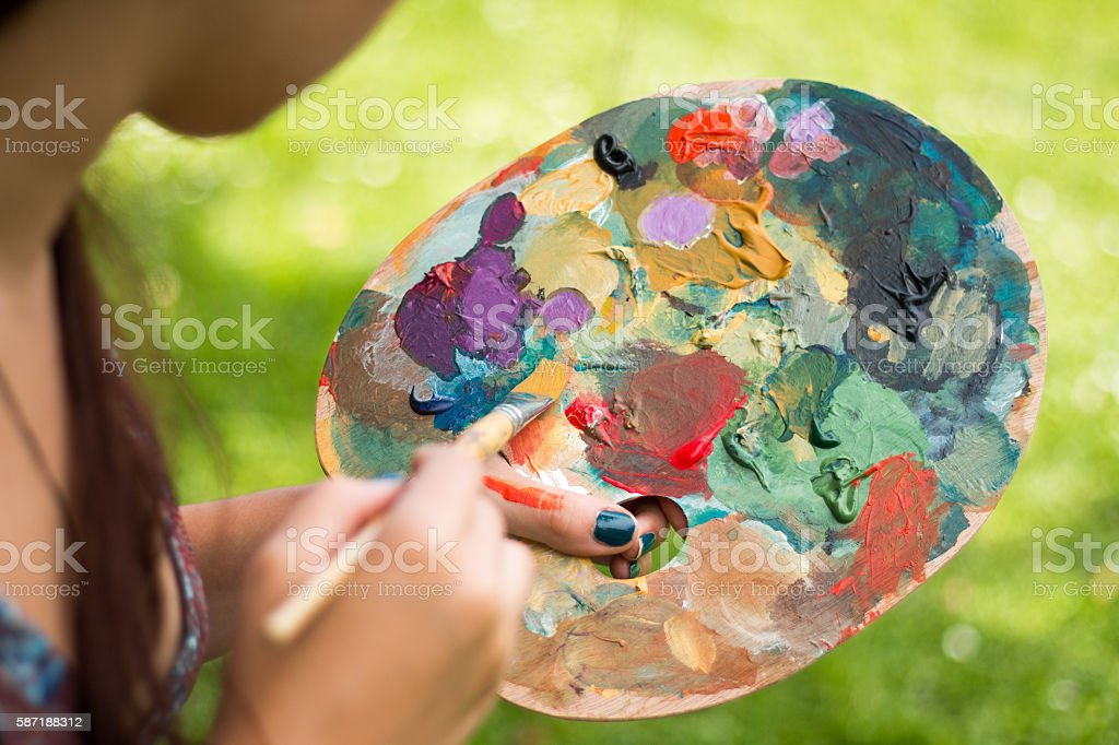 Artist painting, holding palette stock photo