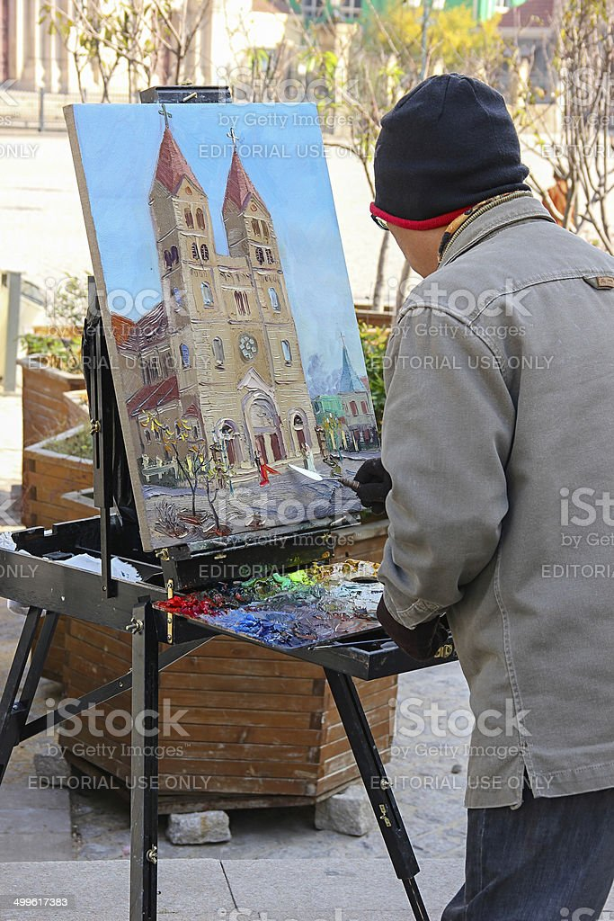 Artist Painting In Front of Church stock photo