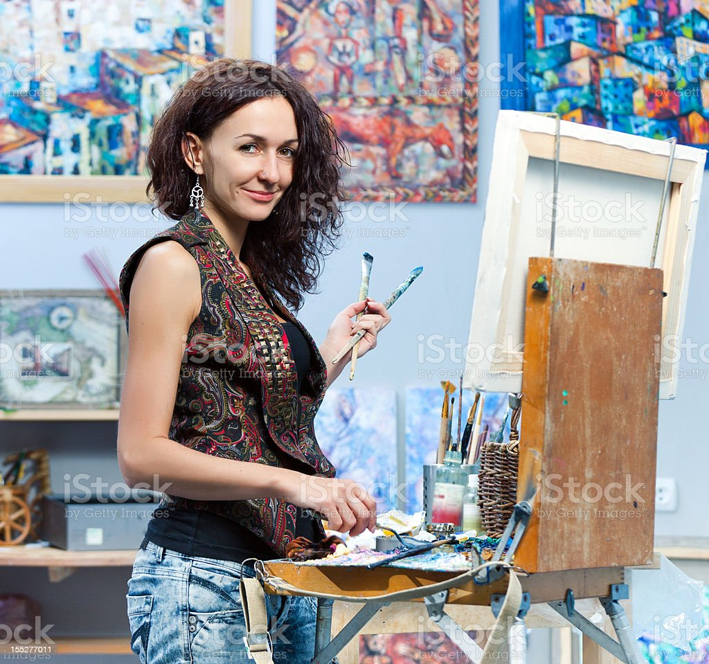 Artist painting in his studio royalty-free stock photo