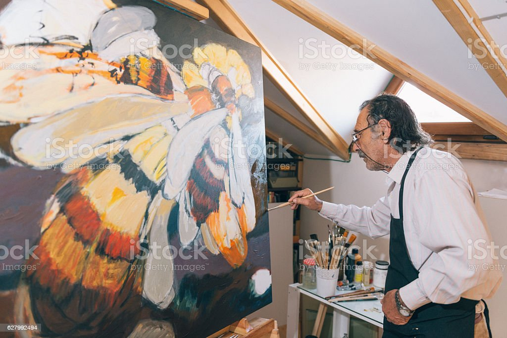 Artist painting in his workshop stock photo