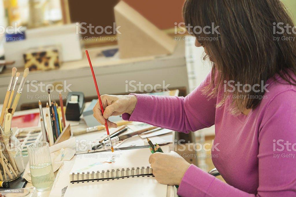 Artist painting in studio stock photo