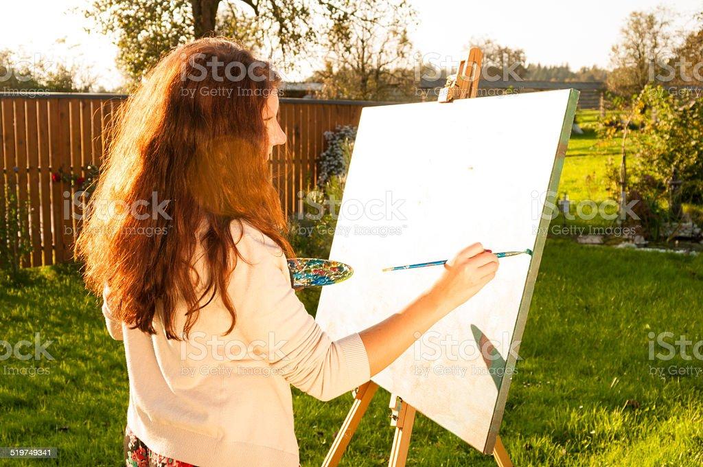 Artist painting in the sun stock photo