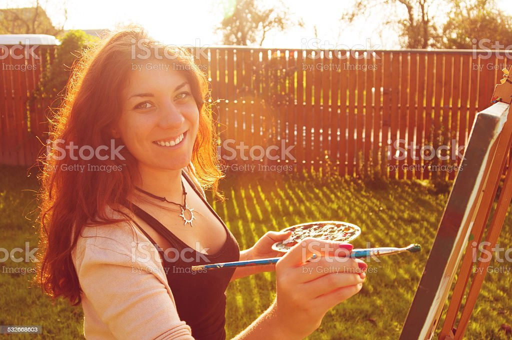 Artist painting in the sun stock photo