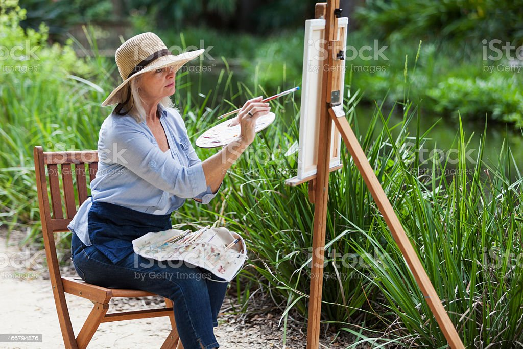 Artist painting nature on canvas stock photo