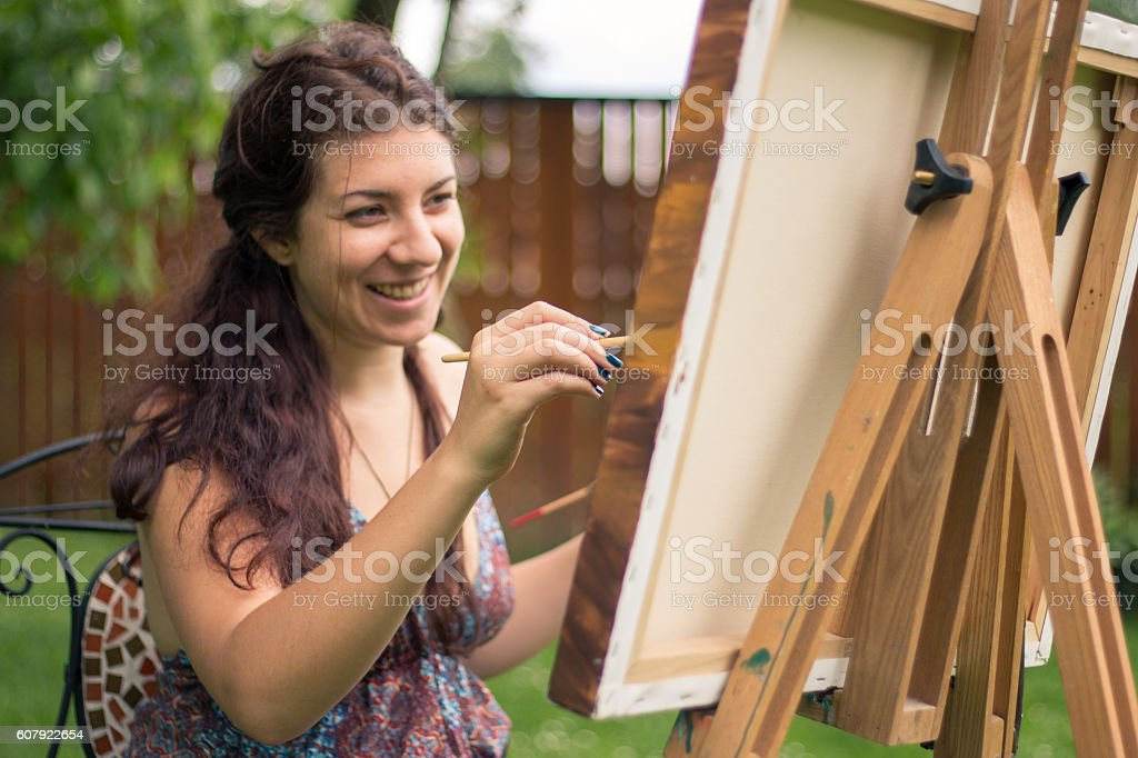 Artist painting outside stock photo