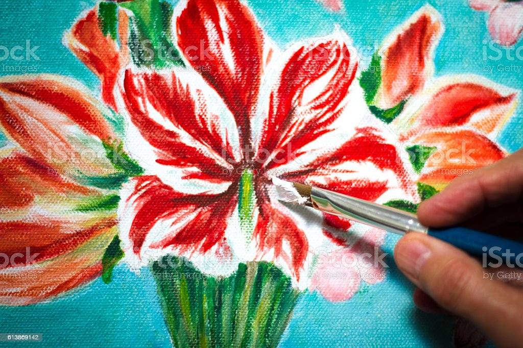 Artist Painting Red Flowers; Hand with Paintbrush Close-Up stock photo