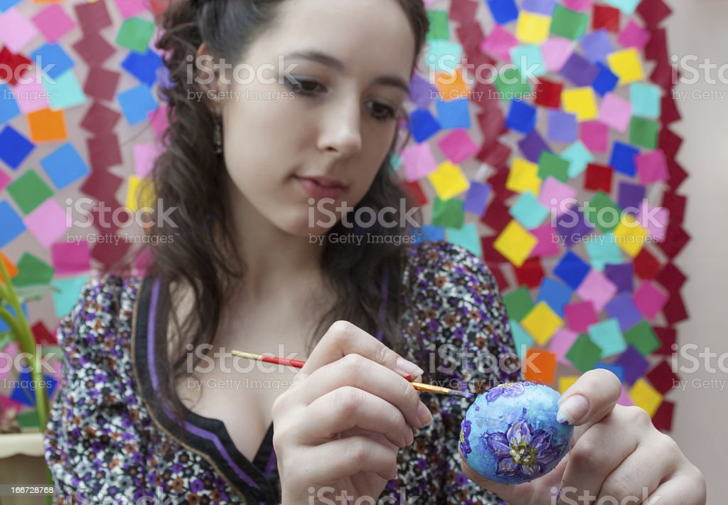 Artist paints an Easter egg royalty-free stock photo