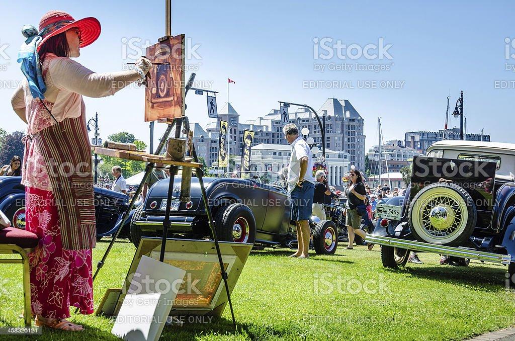 Artist paints car exhibited at Northwest Deuce Days royalty-free stock photo