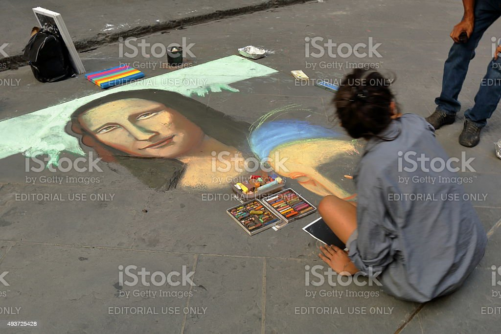 Artist paints face of a Mona Lisa in Florence, Italy stock photo