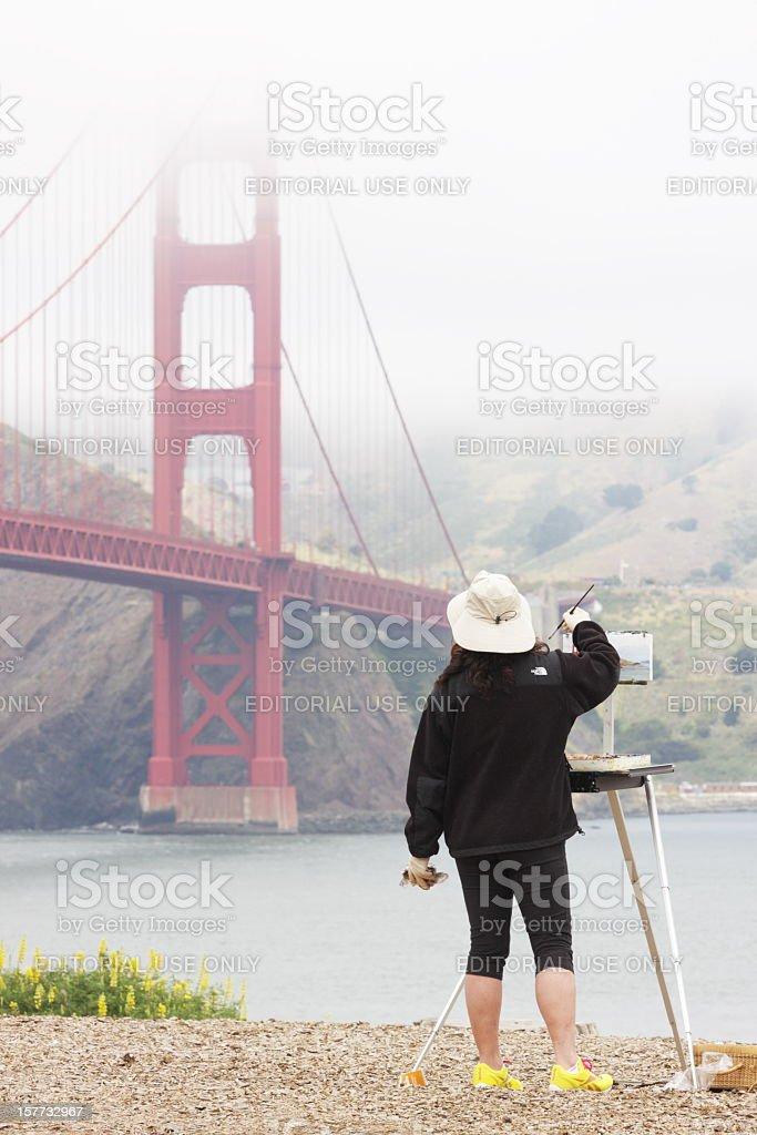 Artist Paints Golden Gate Bridge Fog royalty-free stock photo