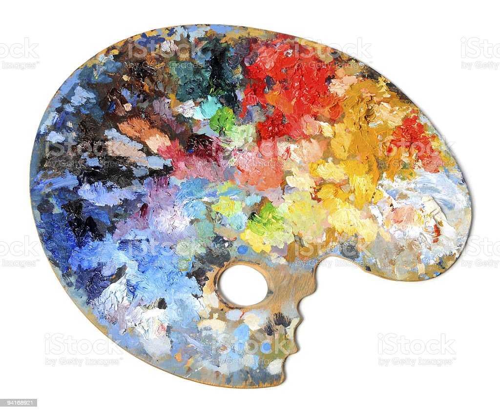 Artist palette covered in paint on a white background stock photo