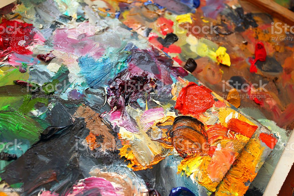 Artist palette with vibrant colors and oil pigments stock photo