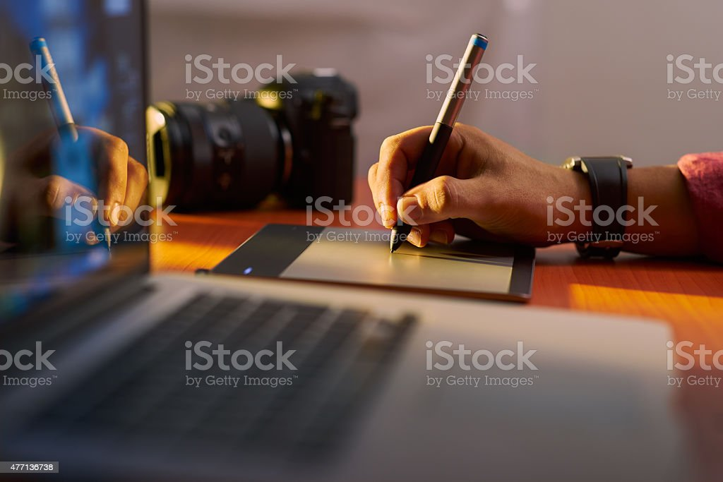 Artist Photographer Retouches Photo On Computer With Graphic Tab stock photo