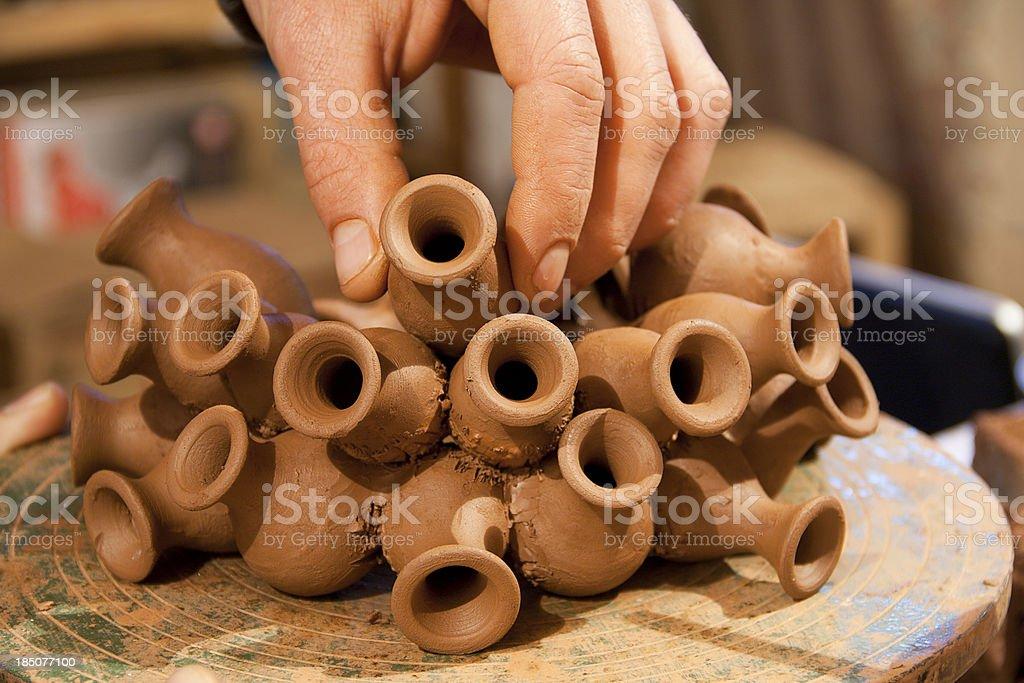 Artist pottery working on ceramic vases stock photo
