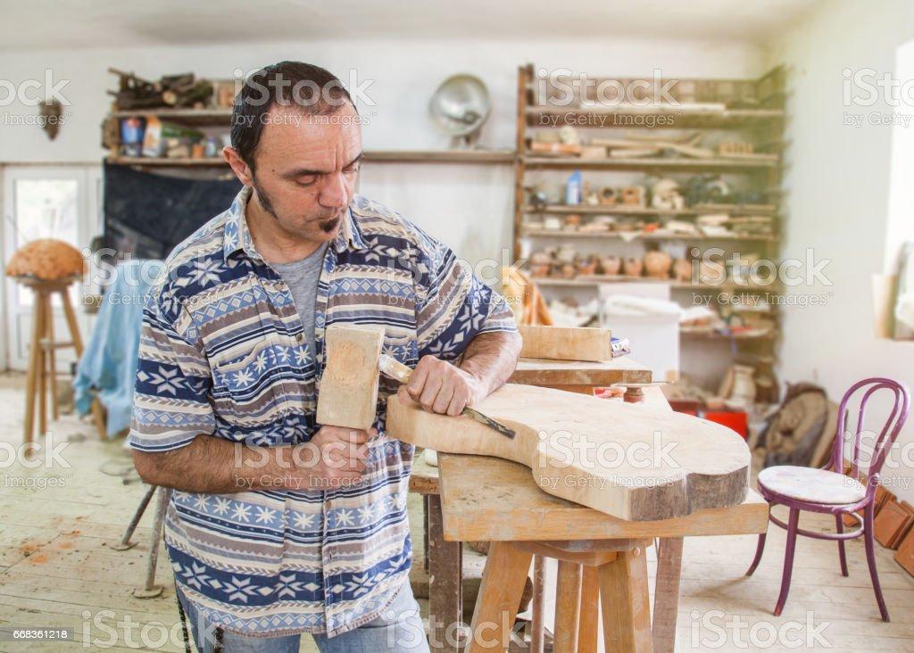 artist processing wood stock photo