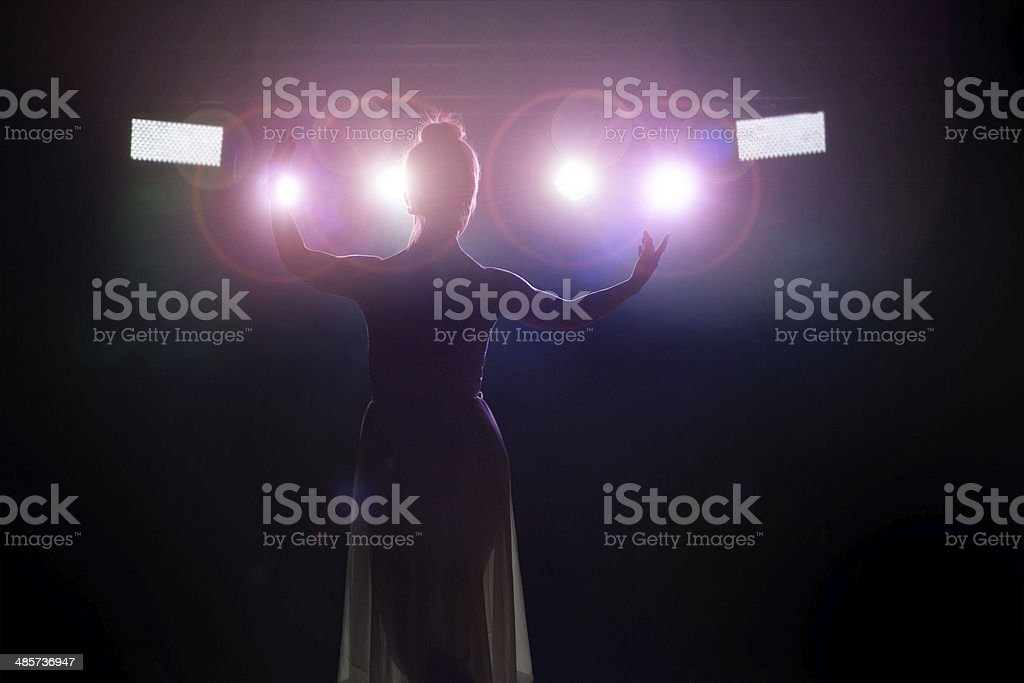 Artist saluting the public stock photo