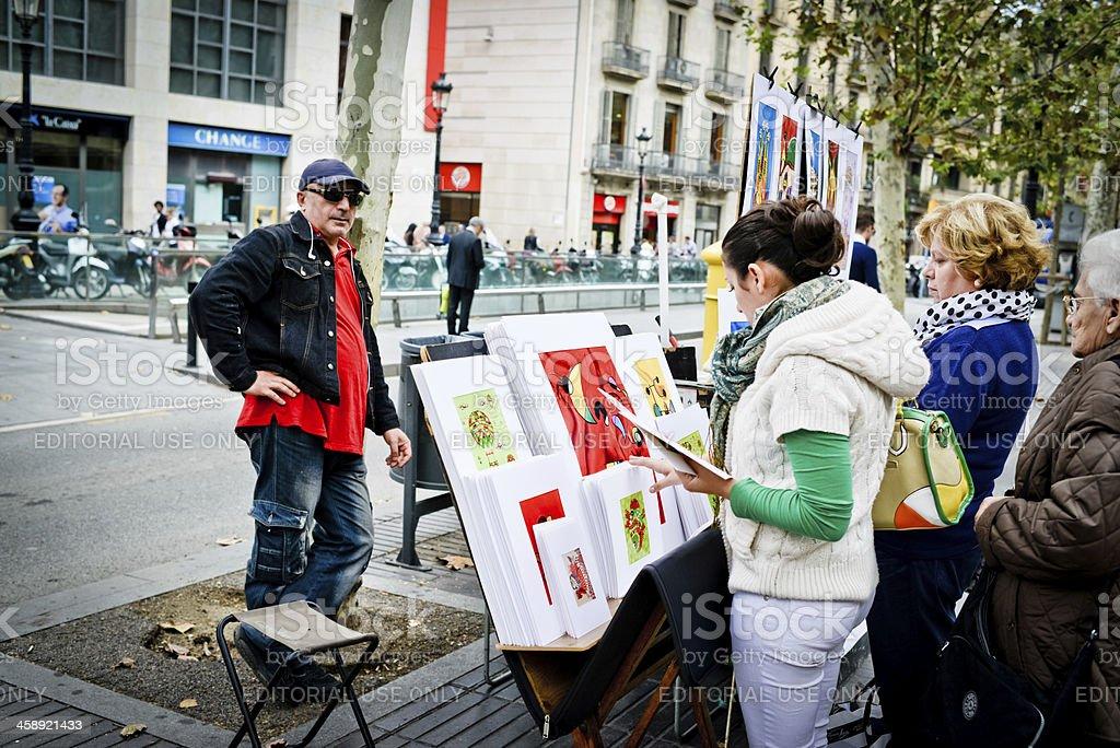 Artist selling his work on the famous La Rambla, Barcelona royalty-free stock photo