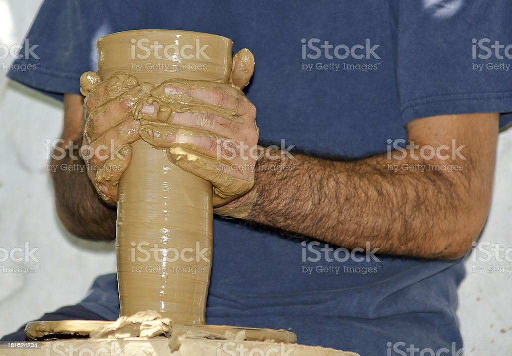 Artist shaping vase on a pottery wheel royalty-free stock photo