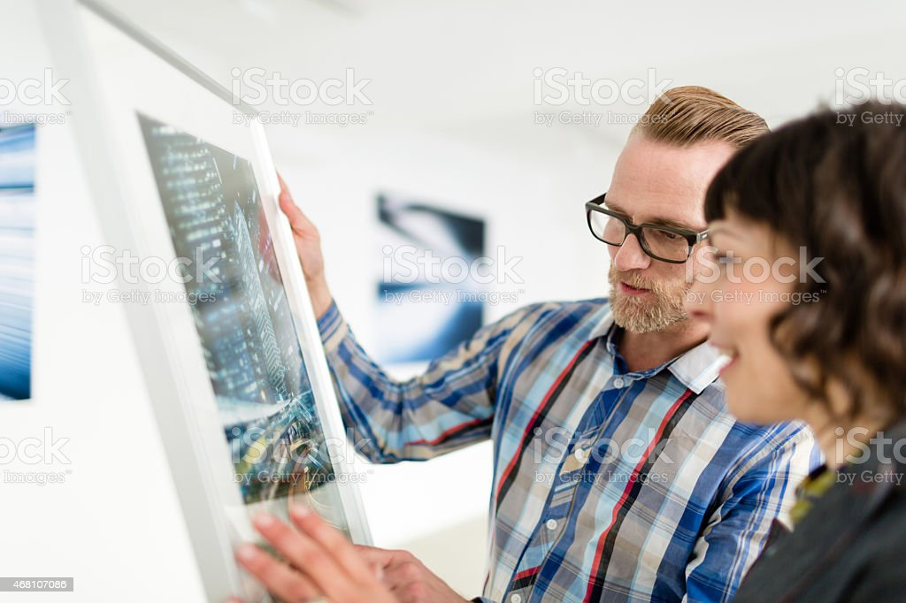 Artist Showing Gallery Owner His Work stock photo