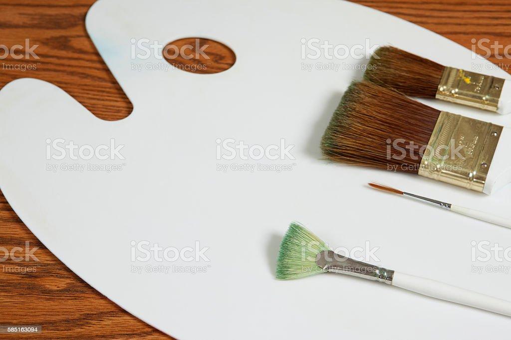 Artist Used Paintbrushes on Art Palette stock photo