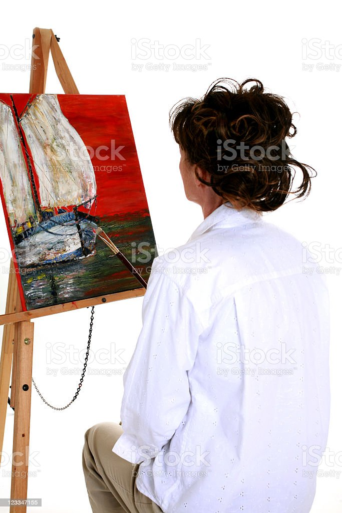 Artist viewing her work. royalty-free stock photo
